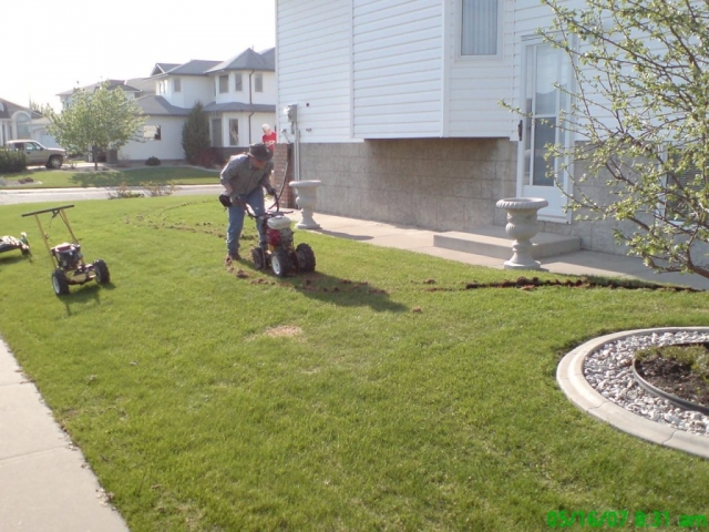 Our own custom built sod cutter- light and maneuverable