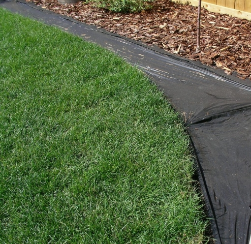 """Good ground Prep we do prefer if the fabric stops 3-4"""" from the turf edge"""
