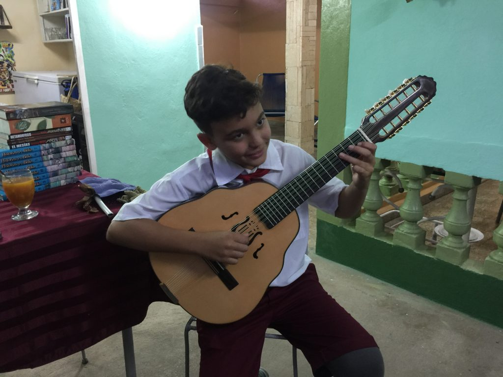 cuban boy playing the Laud